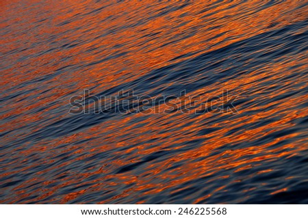 Water ripples, sea sunset background - stock photo