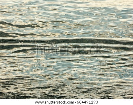 water ripples with three horizontal lines and some turbulence at the front