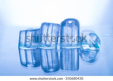water round ice cubes with hole in the center, as a background - stock photo