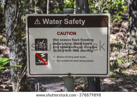 Water safety sign - wet season - in the Northern Territory, Australia - stock photo