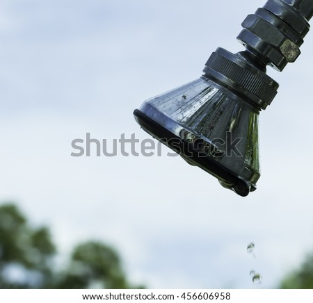 Water saving water, save, savings, concept, green, earth, eco, campaign, life, grass, planet, home, awareness, tree, responsibility, droplet, family, protection, world, drop, protect, money, - stock photo