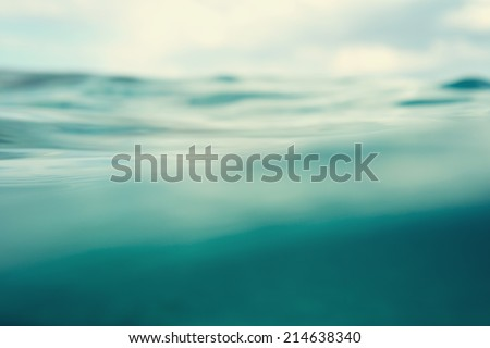 Water. Sea. Ocean, Wave close up. Nature background. Soft focus. Image toned and noise added. - stock photo