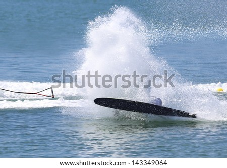 Water skier spray, skier falls - stock photo