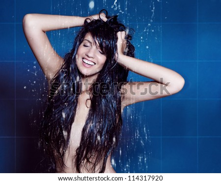 water-spa girl enjoying shower - stock photo