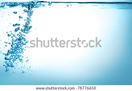 water splash and water bubbles in blue - stock photo