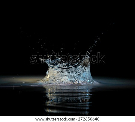 Water splash in black - stock photo