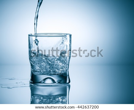 water splash in glass - stock photo