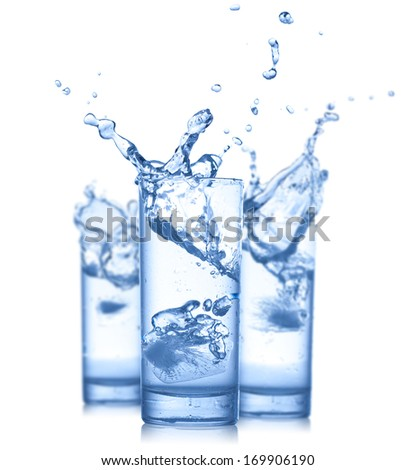 Water splash in glasses isolated on white - stock photo
