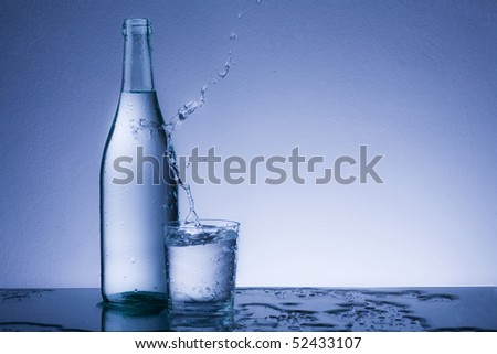water splash in the glass - stock photo