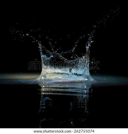 Water splash on black background - stock photo