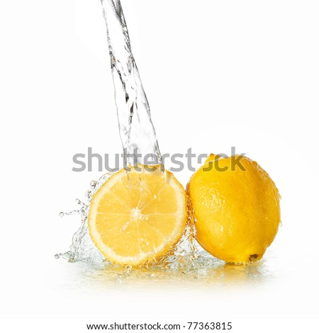 Water splash on lemon - stock photo