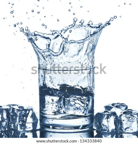 Water splash out of glass - stock photo