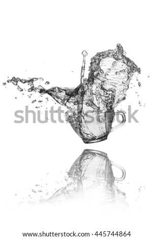 water splash out of glass on black background.