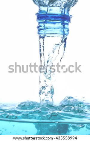 water splash - pour water from bottle -  liquid wet wash splashing clear clean wave white gray blue background bubble - stock photo