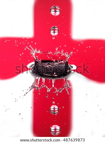 Water splash with cross of St George backdrop
