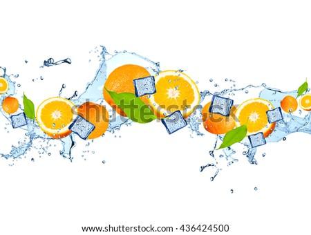 Water splash with fruits and ice cube isolated on white background. Fresh orange - stock photo
