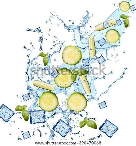 Water splash with vegetable isolated on white backgroud. Fresh cucumber - stock photo