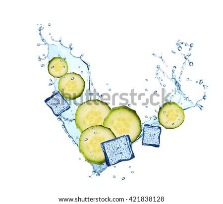 Water splash with vegetable isolated on white background. Fresh cucumber - stock photo