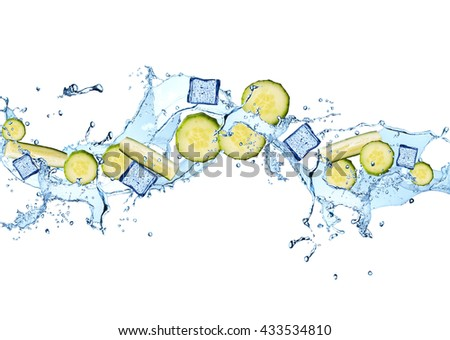 Water splash with vegetable isolated on white background. Fresh cucumber - stock photo
