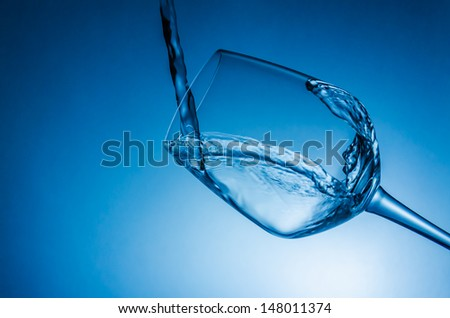 Water splash with wine glass