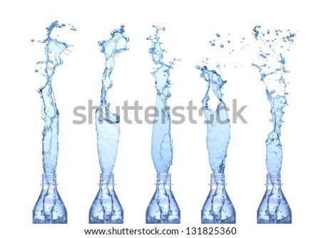 Water splashes from a bottles. Isolated on white - stock photo