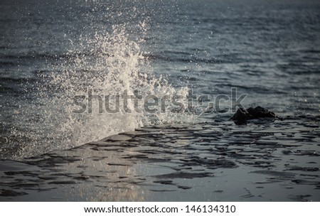 Water splashes in a stormy dark sea  - stock photo