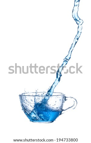 water splashing from glass  on white background . - stock photo