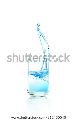 water splashing in transparent glass