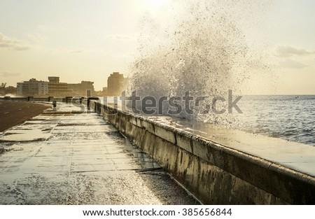 water splashing over the pier in havana, Cuba - stock photo