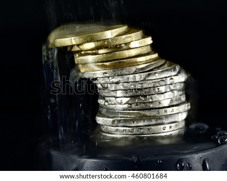 water spluttering over Euro coins