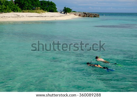 water sports and other activities on the Dry Tortugas in the shallow crystal clear waters - stock photo