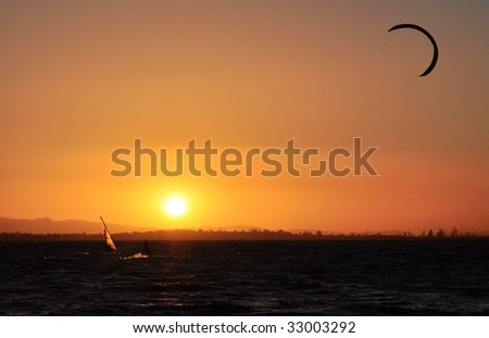 Water sports at sunset - stock photo