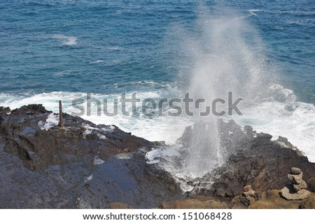 Water spouts through the Halona Blowhole, a hole in the rocks along the coast of Oahu, Hawaii