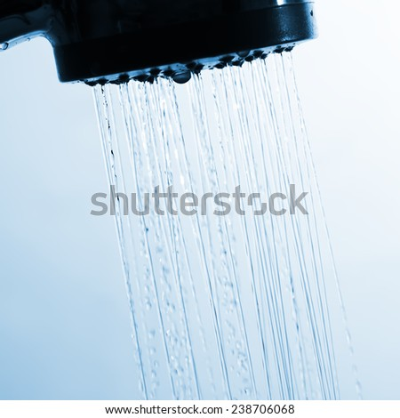 Water spray flowing from showerhead - stock photo