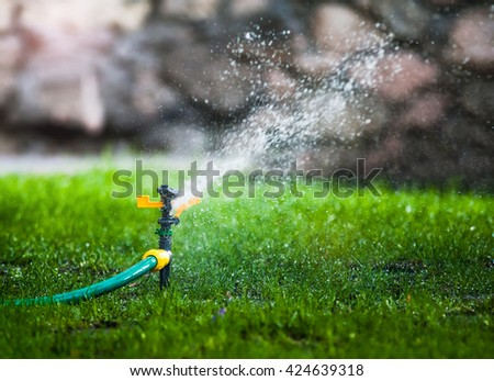 water sprayer in the park in summer - stock photo