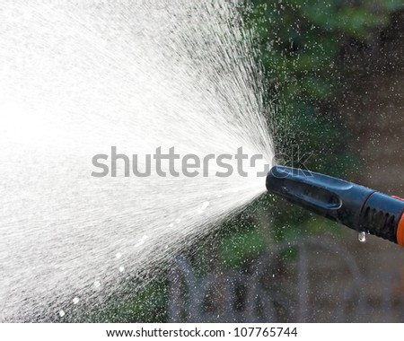 Water spraying from a garden hose