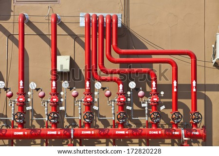 water sprinkler and fire alarm system, water sprinkler control system, fire alarm system, fire control system, fire fighting system, water sprinkler control panel - stock photo
