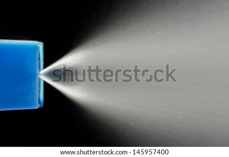 Water squirting from water spray bottle - stock photo