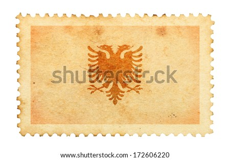 Water stain mark of Albania flag on an old retro brown paper postage stamp.  - stock photo