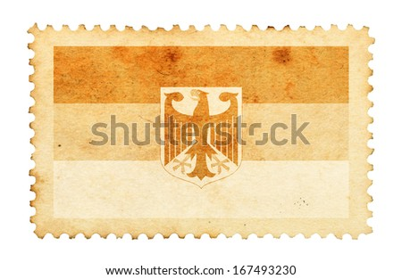 Water stain mark of Germany flag on an old retro brown paper postage stamp. - stock photo