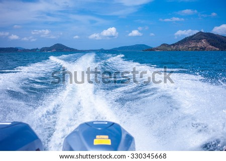 Water stream after speed boat. Summer landscape, a warm Sunny day on the Islands in Asia - stock photo