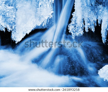 Water stream frozen in winter, nature. - stock photo