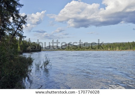 Water summer landscape surrounding the river Suntar in the Highlands of Oymyakon, Yakutia, Russia.
