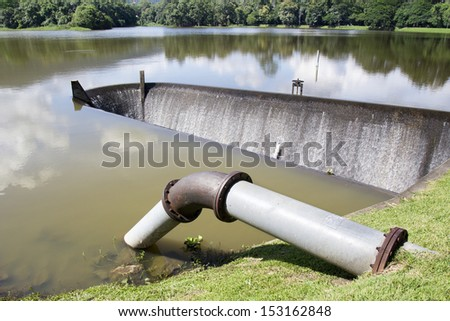 Water supply pipe and dam - stock photo