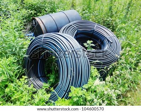 Water supply pipe in farmland - stock photo
