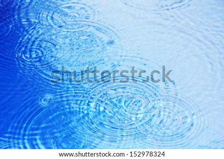 water surface in the pool with raindrops - stock photo
