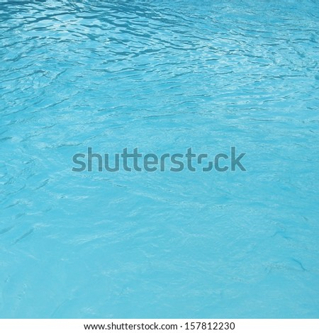 Water surface in the swiming pool - stock photo