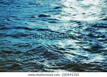 Water surface of the sea at night close up - stock photo