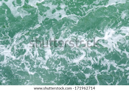 Water surface with brightness in the distance - stock photo