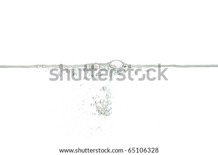 Water surface with small air bubbles isolated on a white background.
